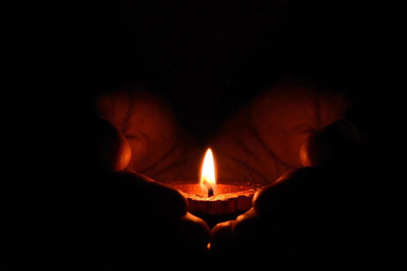 Tealight Candle On Human Palms 783200